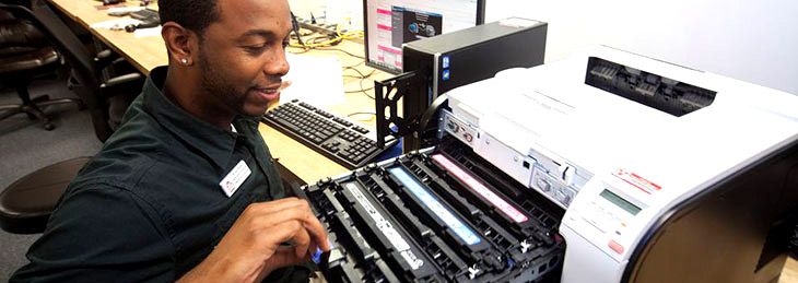 Technician Repairing Printer